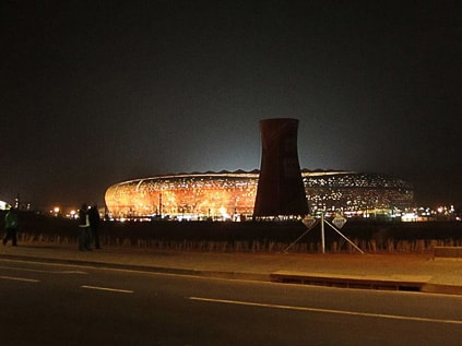 Soccer City Stadium with mining cooling tower in front